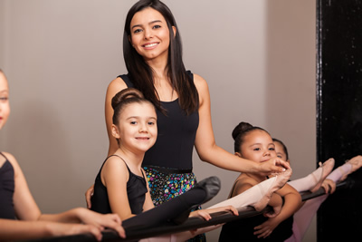 Dance teacher with young students